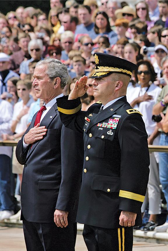 President George W. Bush attending a Memorial Day wreath-laying ceremony at the Tomb of the Unknowns at Arlington National Cemetery with Military District of Washington commander Maj. Gen. Richard J. Rowe, Jr., USA, in Arlington, VA, May 26.