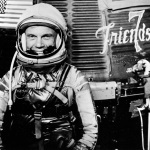 John Glenn in front of the Friendship 7 capsule