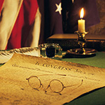 Declaration of Independence with American flag in the background