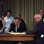 President Johnson signing the Medicare Law of 1965