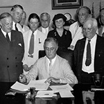 President Roosevelt signing the Social Security Act